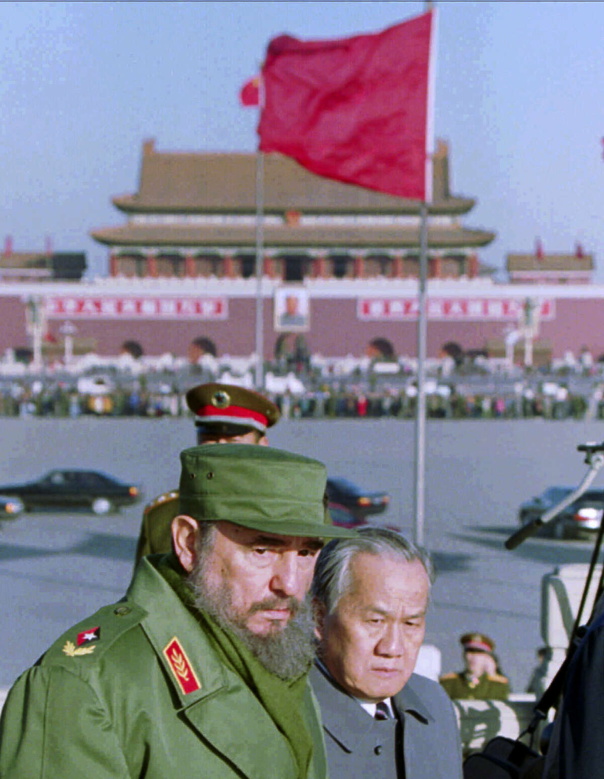 In this Dec. 2, 1995, file photo, Cuban President Fidel Castro tours Beijing's Tiananmen Square after laying a wreath at the Monument to the People's Heroes, which commemorates fallen communist revolutionaries. Castro, who led a rebel army to victory in Cuba, embraced Soviet-style communism and defied the power of 10 U.S. presidents during his half century rule, died at age 90 on Friday, Nov 25, 2016. Viewed from the world'Äôs largest communist country, Castro'Äôs death is a reminder of how the communist axis has changed beyond recognition since the ideologically charged era when the bearded revolutionary cut a dashing figure on the world stage alongside leaders like Mao Zedong.