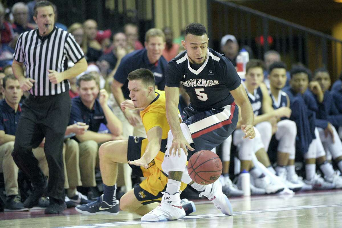 Gonzaga guard Nigel Williams-Goss (5) and Quinnipiac guard Peter Kiss, left, fight for a loose ball during the second half of an NCAA college basketball game at the AdvoCare Invitational tournament in Lake Buena Vista, Fla., Thursday, Nov. 24, 2016. Gonzaga won 82-62. (AP Photo/Phelan M. Ebenhack)