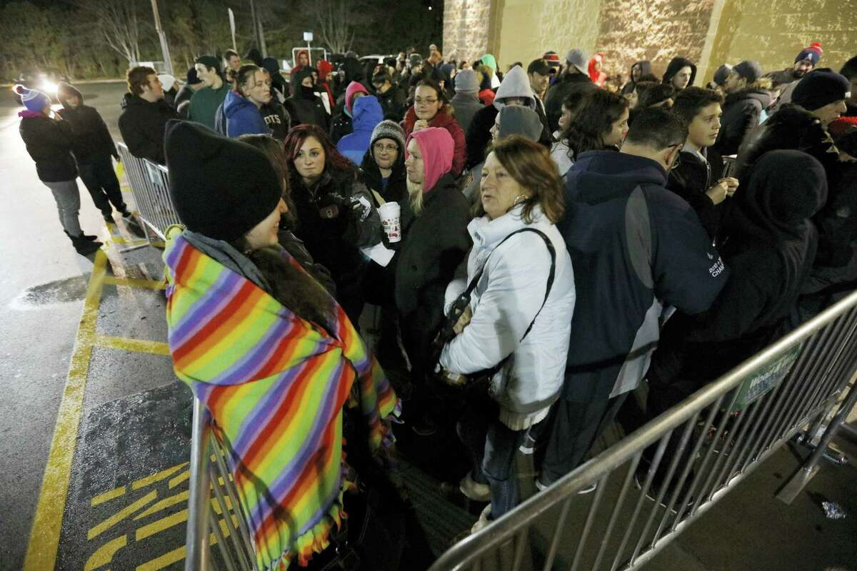 Shoppers wait for doors to open at Walmart on Black Friday, in Dartmouth, Mass., Nov. 25, 2016. Stores open their doors Friday for what is still one of the busiest days of the year, even as the start of the holiday season edges ever earlier.