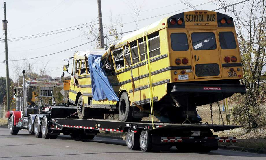 A school bus is carried away in Chattanooga, Tenn., from the site where it crashed. Photo: Mark Humphrey — AP File Photo / Copyright 2016 The Associated Press. All rights reserved.