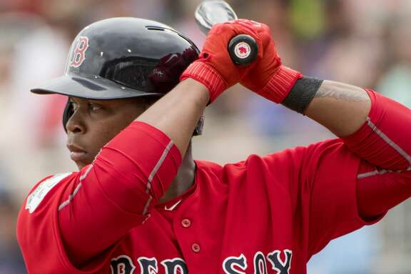 FORT MYERS, FL - FEBRUARY 23:  Rafael Devers #74 of the Boston Red Sox bats against Northeastern University on February 23, 2017 at jetBlue Park in Fort Myers, Florida.   (Photo by Michael Ivins/Boston Red Sox/Getty Images)