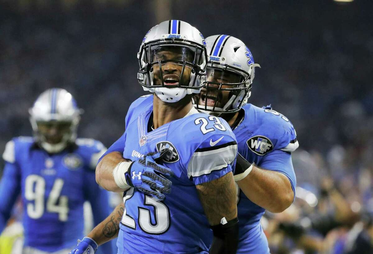 Detroit Lions cornerback Darius Slay (23) is hugged by defensive tackle Haloti Ngata (92) after his interception during the second half against the Minnesota Vikings, Thursday in Detroit.