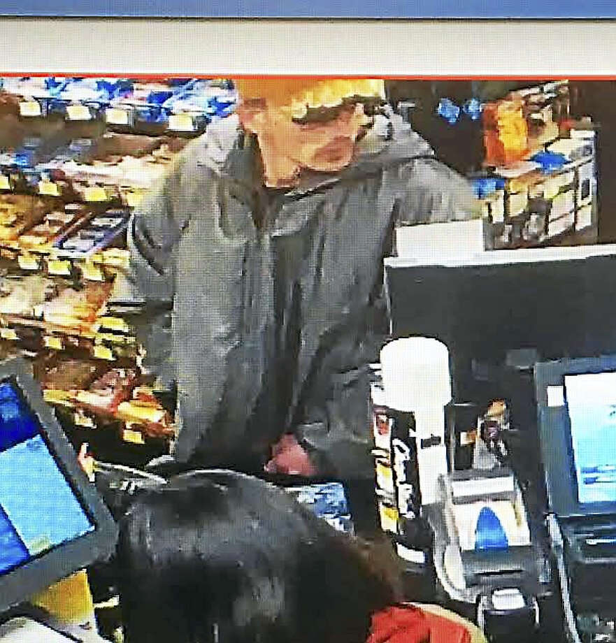 State police are looking for this man who they say is a suspect in an early-morning robbery in Orange. Photo: CONNECTICUT STATE POLICE