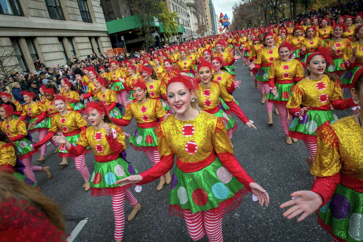 Dancers move down Central Park West during the Macy's Thanksgiving Day Parade in New York last year. A giant Charlie Brown balloon will join 1,000 clowns and a dozen marching bands along a parade route lined with spectators and police in plainclothes for the 90th annual parade.