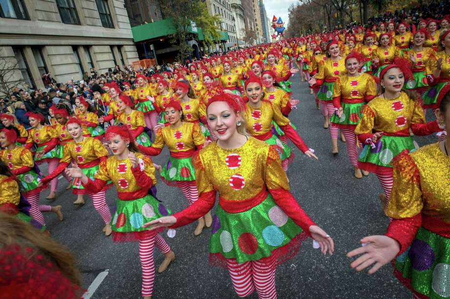 Dancers move down Central Park West during the Macy's Thanksgiving Day Parade in New York last year. A giant Charlie Brown balloon will join 1,000 clowns and a dozen marching bands along a parade route lined with spectators and police in plainclothes for the 90th annual parade. Photo: Bryan R. Smith — AP File Photo / FRE171336 AP