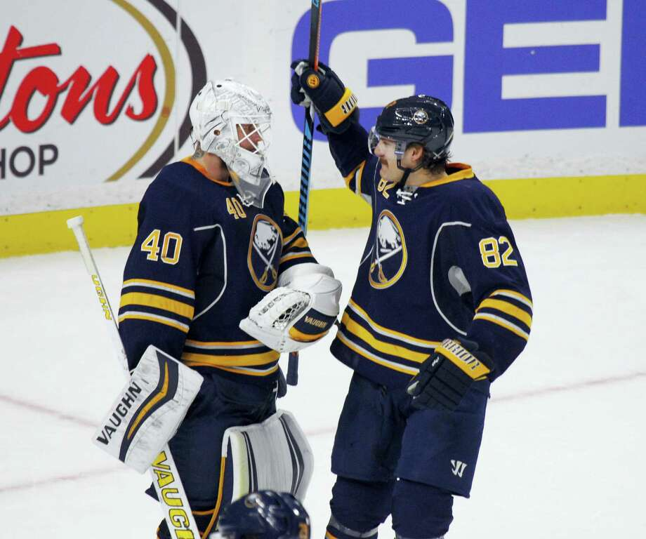 Buffalo Sabres Marcus Foligno (82) celebrates a 4-2 victory over the Calgary Flames with goalie Robin Lehner (31) during the third period of an NHL hockey game on Nov. 21, 2016 in Buffalo, N.Y. Photo: AP Photo/Jeffrey T. Barnes   / 2016