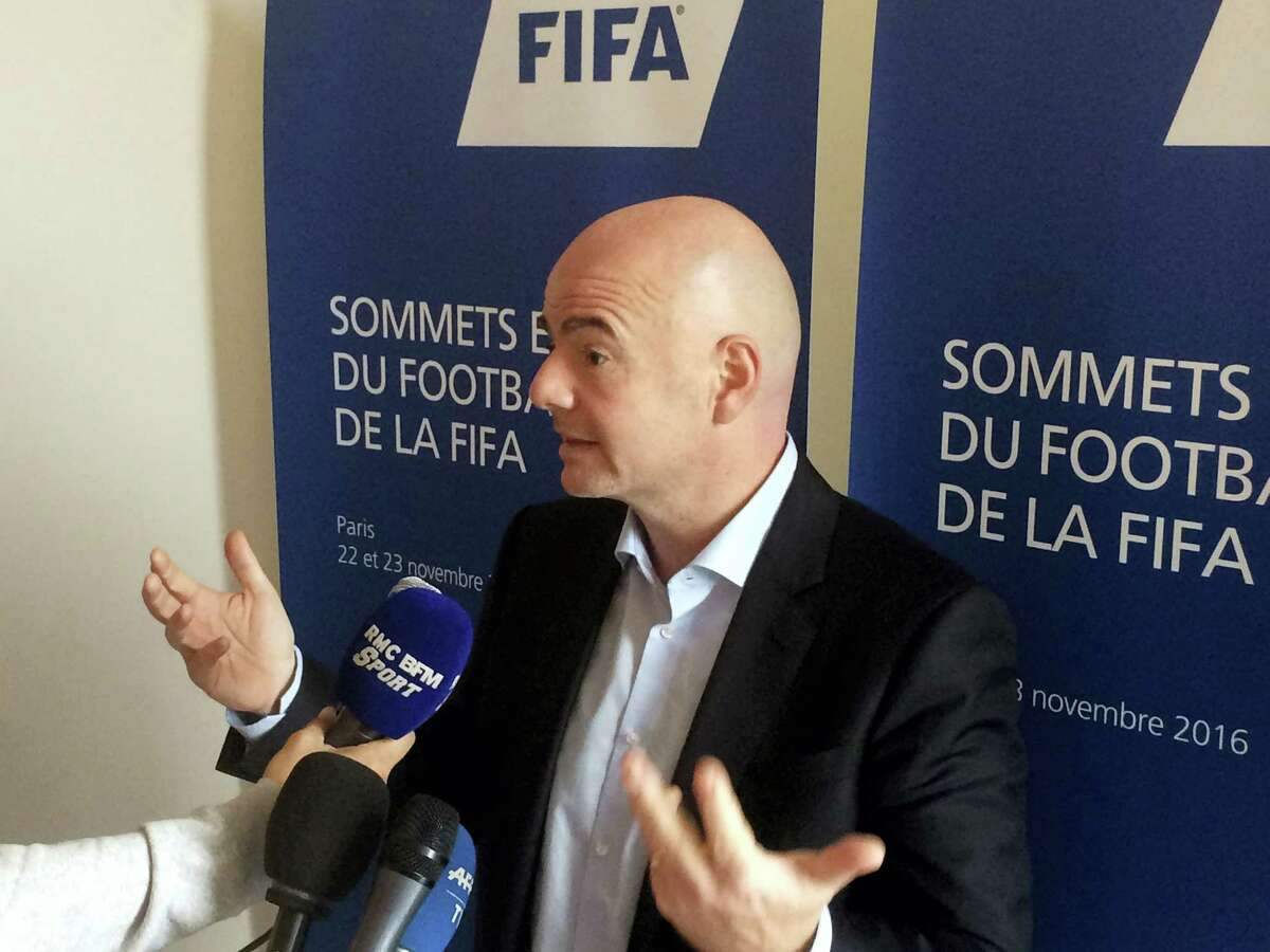 FIFA President Gianni Infantino answers reporters after a FIFA Executives meeting in Roissy, outside Paris on Nov. 23, 2016. Infantino says he's warming to a World Cup expanded to 48 teams but still hasn't decided whether 40 nations might not be better.