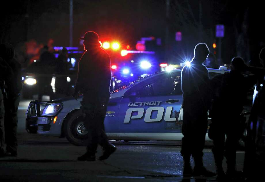 """Police search the area where an officer who works for Wayne State University was shot in the head while on duty near the campus Tuesday, Nov. 22, 2016, in Detroit. Authorities said they have a """"person of interest"""" in custody in the investigation into the shooting of the police officer. Photo: Paul Sancya — AP Photo / Copyright 2016 The Associated Press. All rights reserved."""