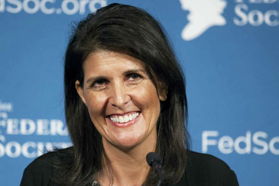 In this Nov. 18, 2016 photo, South Carolina Gov. Nikki Haley smiles while speaking at the Federalist Society's National Lawyers Convention in Washington. President-elect Donald Trump has chosen Haley as U.S. ambassador to the United Nations, and he will treat the ambassadorship as a Cabinet-level position, according to two sources familiar with Trump's decision who requested anonymity to discuss the decision and its announcement. Photo: Cliff Owen — AP File Photo   / FR170079 AP