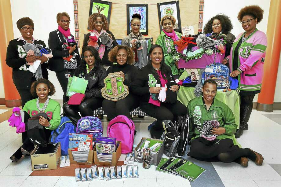 Kappa Alpha Kappa sorority members, front row from left, Adrienne Lucas, Shannon Bowers, chapter President Cathy Patton, Dori Dumas and Lauren Williams; and back row, from left, Sondi Jackson, Shenae Draughn, Marlene Graham, Pia Grasty, Eboni Douglas, Jaryn Travers and Khalilah Brown-Dean at Wexler-Grant School in New Haven. Photo: Catherine Avalone — New Haven Register   / New Haven RegisterThe Middletown Press