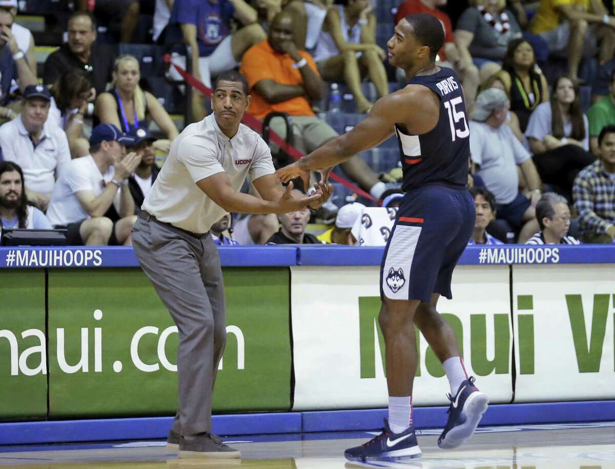 UConne guard Rodney Purvis (15) receives a hand from coach Kevin Ollie during the second half against Chaminade in the Maui Invitational in Lahaina, Hawaii. UConn won 93-82.