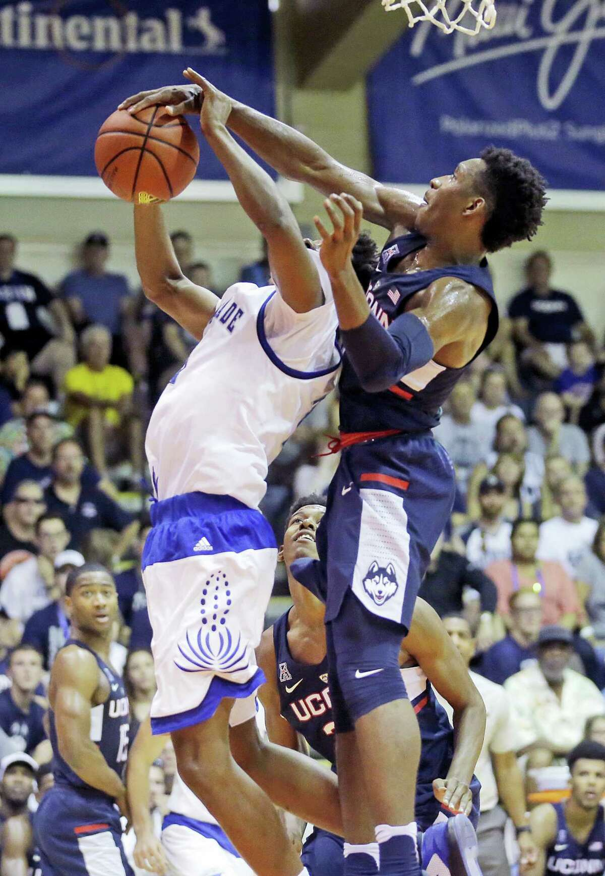 UConn guard Christian Vital, right, blocks the shot of Chaminade guard Rohndell Goodwin, left, in the first half during the Maui Invitational Tuesday.