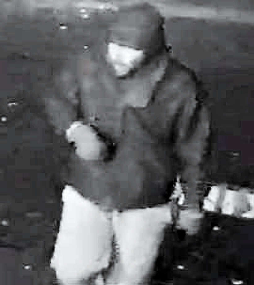 Surveillance images show a robbery suspect at Krauszer's in Hamden on Tuesday morning. Photo: Courtesy Hamden PD