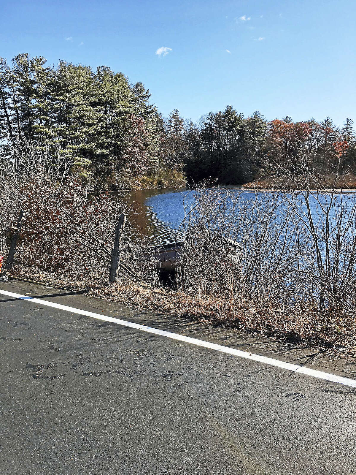 Rescuers pulled a woman out of a car after it went into the water on Waite Street in Hamden on Tuesday afternoon.