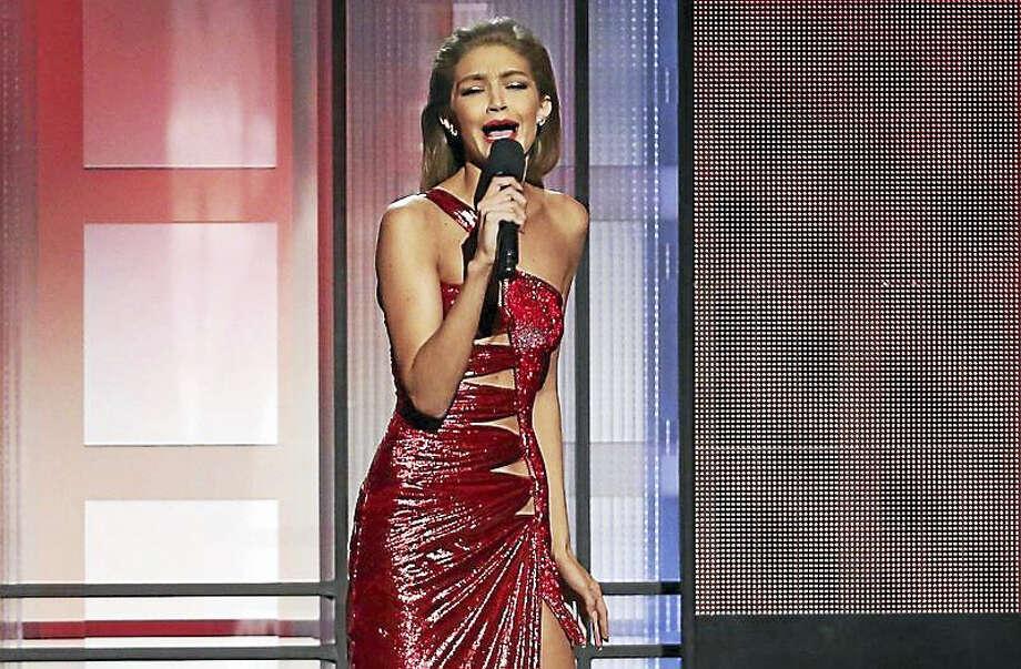 Model Gigi Hadid does unflattering impression of Melania Trump at American Music Awards show. Photo: AP Photo