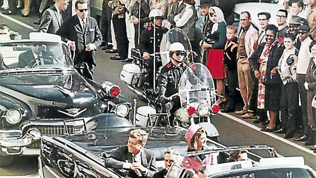 In this Nov. 22, 1963, file photo, President John F. Kennedy's motorcade travels through Dallas.