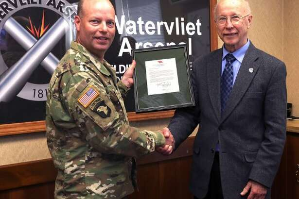 William Martin / Watervliet Arsenal Watervliet Arsenal commander Col. Joseph Morrow gives Robert Pfeil recognition upon Pfeil?s retirement as a civilian employee of Department of Army after 51 years of service.