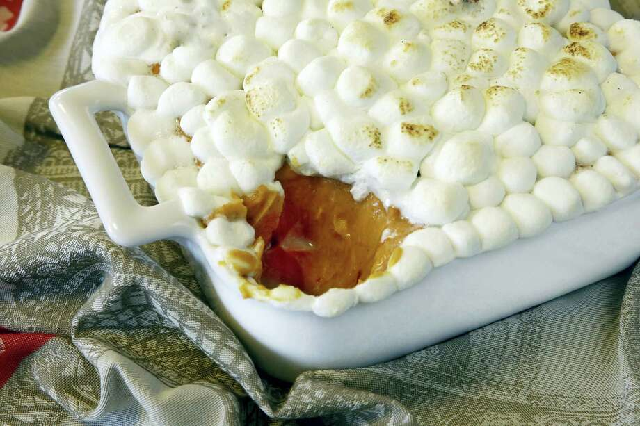 Chipotle sweet potato purée with roasted marshmallows can be made ahead of time to make Thanksgiving prep a little easier. Photo: Richard Drew — The Associated Press   / AP