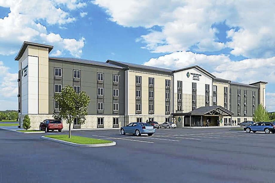 A rendering of the four-story, 123-room WoodSpring Suites extended stay hotel that Wichita, Kan.-based WoodSpring Hotels LLC proposes to build at 480 Sawmill Road, the former site of Staples. Photo: WoodSpring Hotels LLC