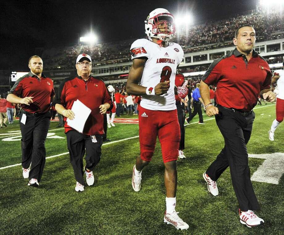 Louisville quarterback Lamar Jackson. Photo: Eric Christian Smith — The Associated Press   / FR171023 AP