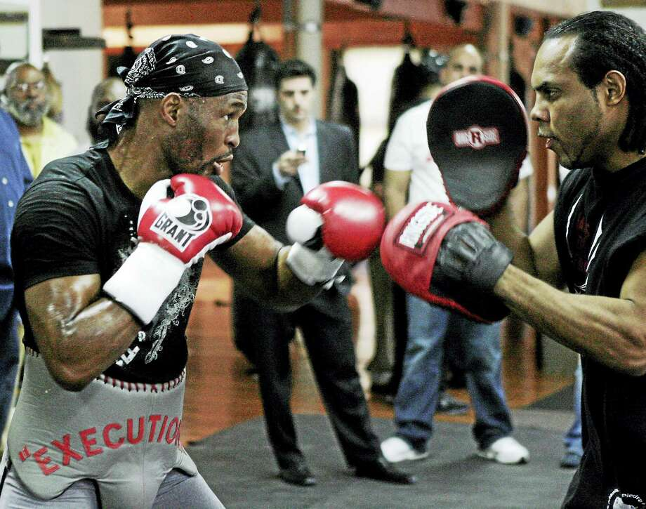 Former light heavyweight boxer Bernard Hopkins, left, with trainer John David Jackson in 2008. New Haven's Cassius Chaney has been training with Jackson for his upcoming fight at Mohegan Sun. Photo: The Associated Press File Photo   / AP