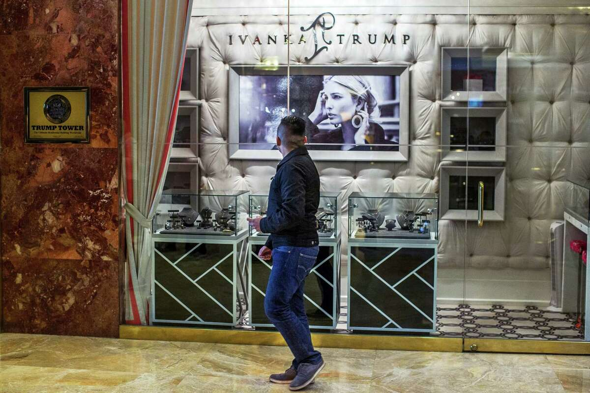 A man looks at the Ivanka Trump collection as he walks inside Trump Tower in New York Nov. 18.