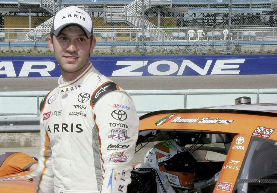 Daniel Suarez heads to the media center after the NASCAR Xfinity auto racing qualifying on Nov. 19, 2016 in Homestead, Fla. Suarez won the pole. Photo: AP Photo/Darryl Graham   / FR46422