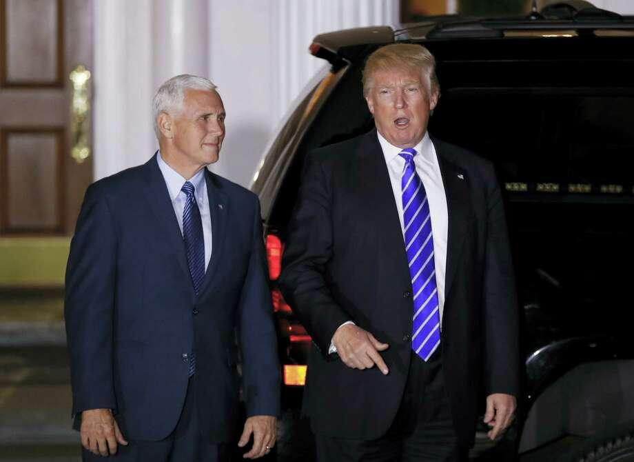 President-elect Donald Trump pauses to talk to media as he walks with Vice President-elect Mike Pence to board his motorcade vehicle at Trump National Golf Club Bedminster clubhouse in Bedminster, N.J. on Nov. 19, 2016 to go back to his residence on the grounds for a break in meetings. Photo: AP Photo/Carolyn Kaster   / Copyright 2016 The Associated Press. All rights reserved.