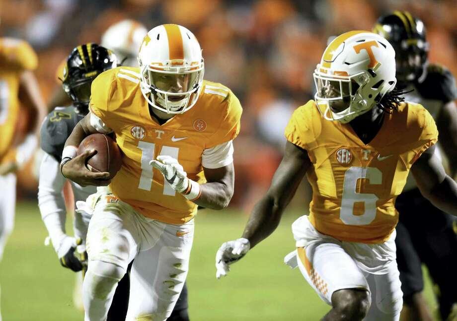 Tennessee quarterback Joshua Dobbs (11) runs against Missouri on Saturday. Photo: Caitie McMekin — Knoxville News Sentinel Via AP   / Knoxville News Sentinel