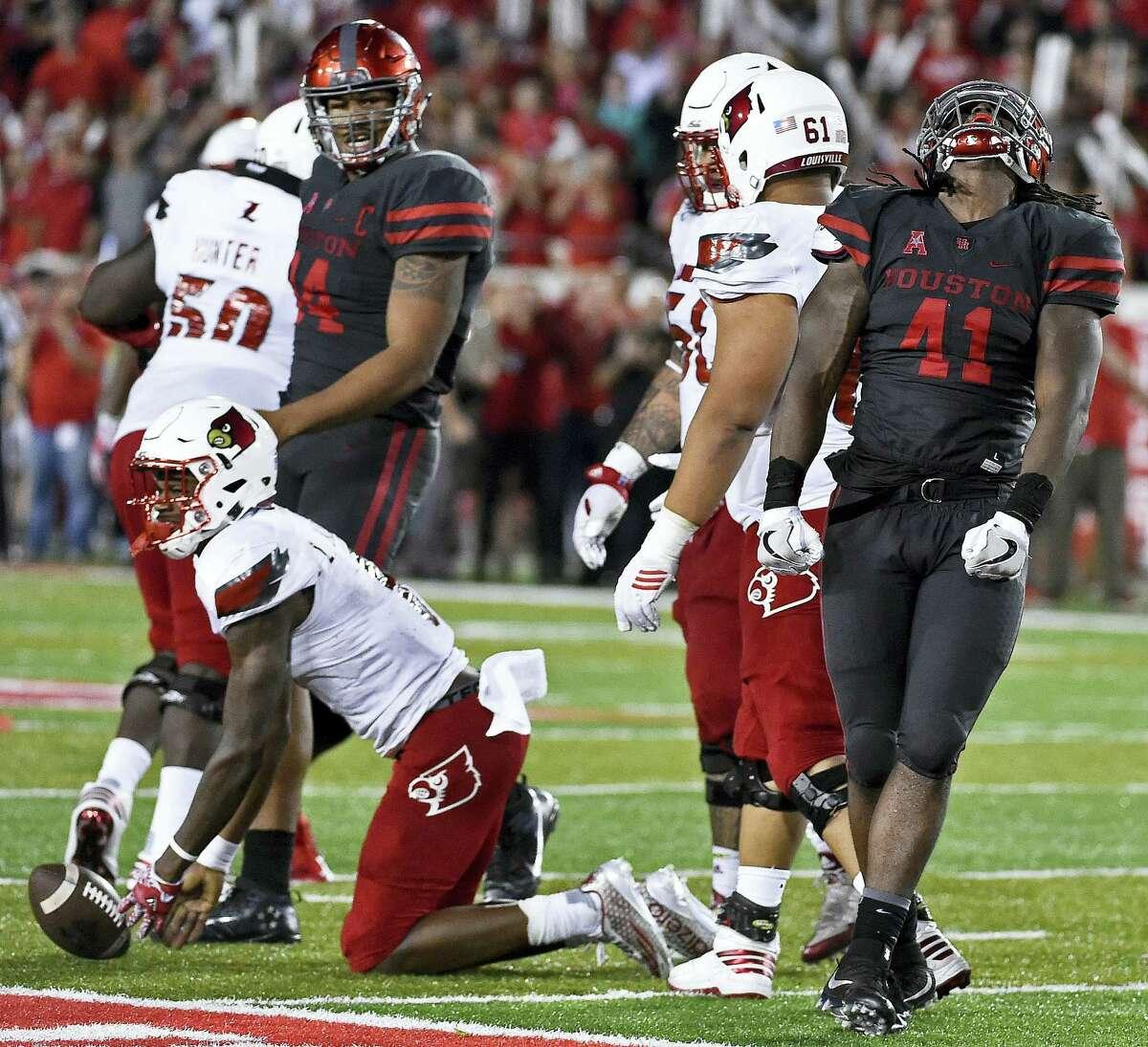 Houston linebacker Steven Taylor (41) reacts after sacking Louisville quarterback Lamar Jackson Saturday.
