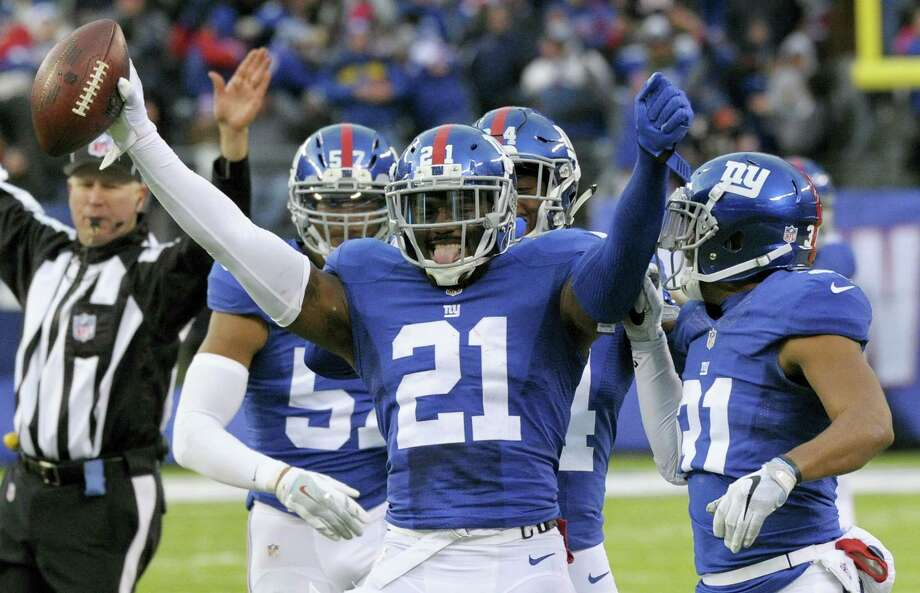 Giants strong safety Landon Collins (21) celebrates after intercepting a pass in fourth quarter Sunday. Photo: Bill Kostroun — The Associated Press   / FR51951 AP