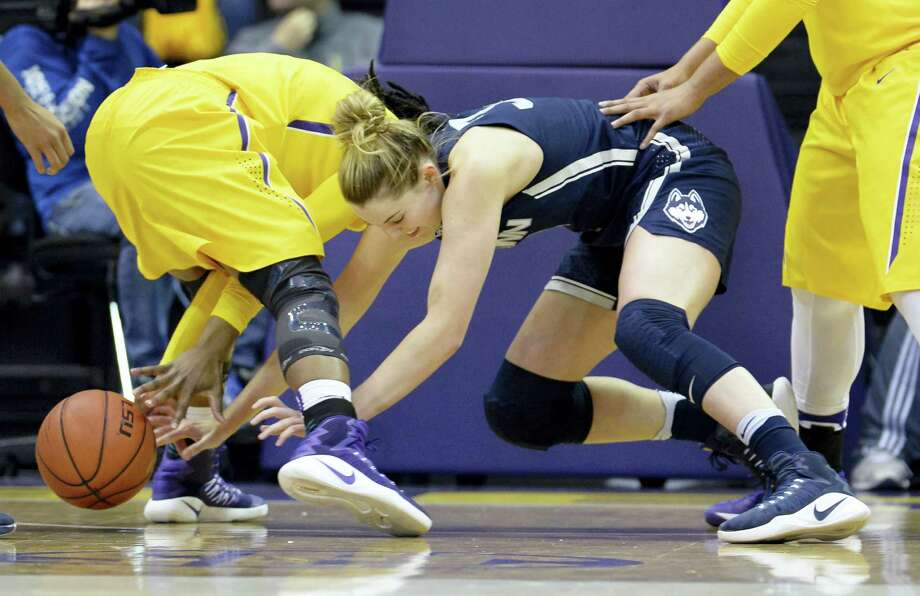 UConn's Katie Lou Samuelson, right, goes after a loose ball that rolled under LSU guard Jasmine Rhodes in the first half Sunday. Photo: Bill Feig — The Associated Press   / FR44286 AP