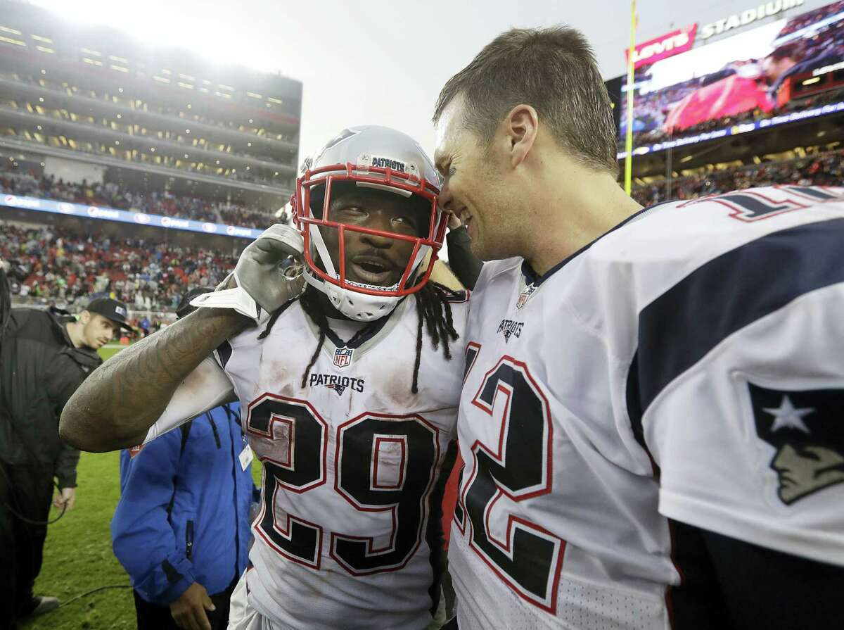 Patriots running back LeGarrette Blount, left, and quarterback Tom Brady celebrate after the Patriots beat the 49ers Sunday.
