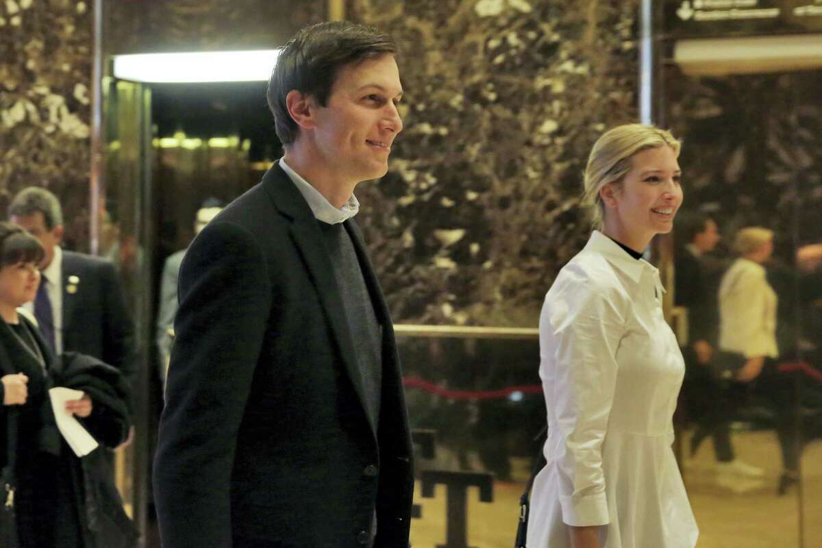 Jared Kushner and his wife Ivanka Trump walk through the lobby of Trump Tower in New York on Nov. 18, 2016.