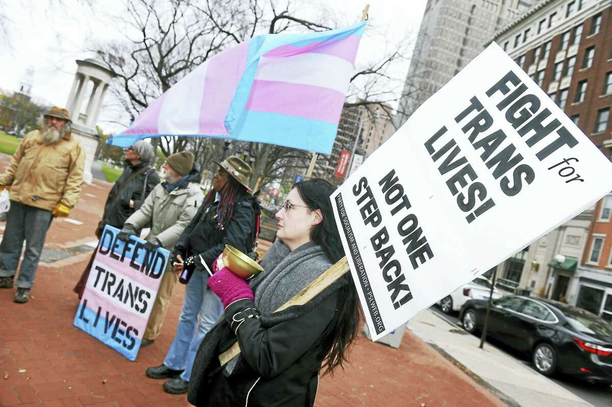 Elizabeth Logan, right, of North Haven attends a rally and speak-out for the annual Transgender Remembrance Day on the New Haven Green Sunday.