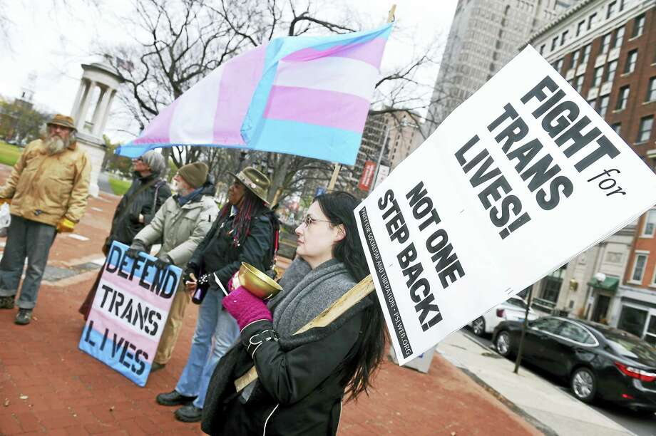 Elizabeth Logan, right, of North Haven attends a rally and speak-out for the annual Transgender Remembrance Day on the New Haven Green Sunday. Photo: Arnold Gold — New Haven Register