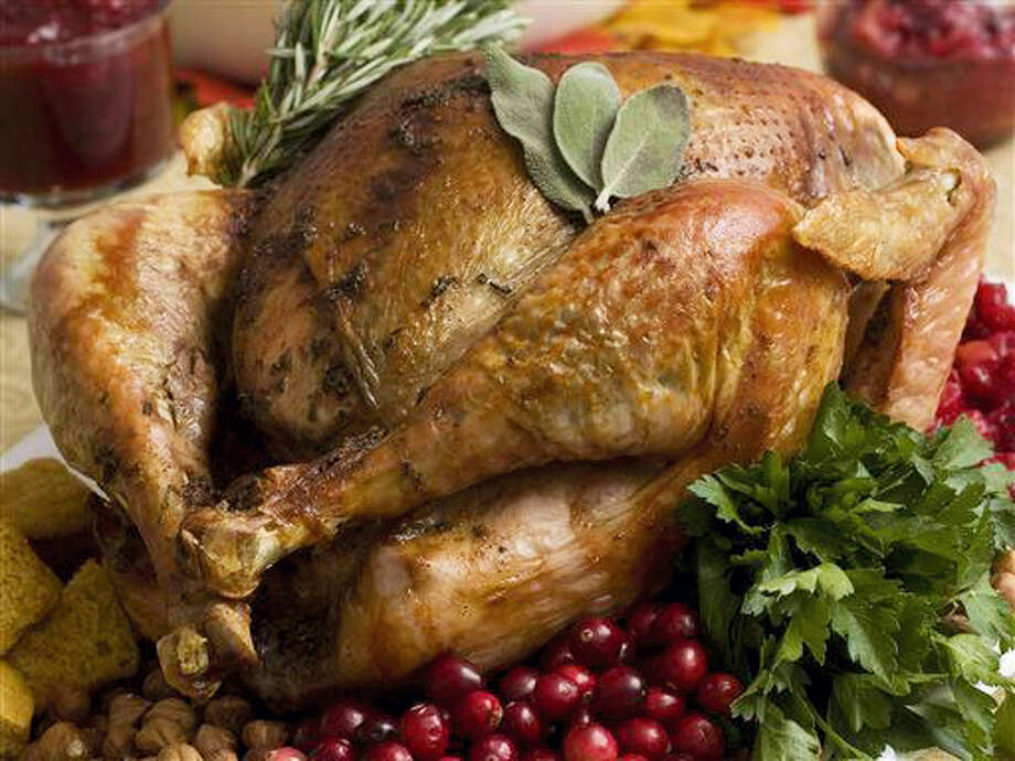 A Thanksgiving turkey: The average Turkey Day dinner will cost $50, but there's a larger cost for those who don't celebrate safely. Photo: AP Photo/Larry Crowe    / A2009