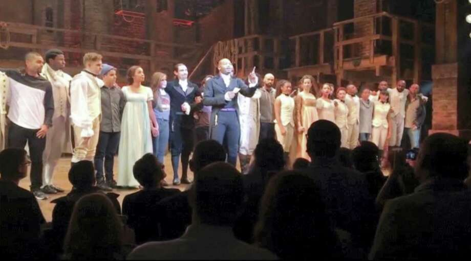 "In this image made from a video provided by Hamilton LLC, actor Brandon Victor Dixon, who plays Arron Burr, the nation's third vice president, in ""Hamilton"" speaks from the stage after the curtain call in New York, Friday, Nov. 18, 2016. Vice President-elect Mike Pence is the latest celebrity to attend the Broadway hit ""Hamilton,"" but the first to get a sharp message from a cast member from the stage. Photo: Hamilton LLC Via AP    / Hamilton LLC"