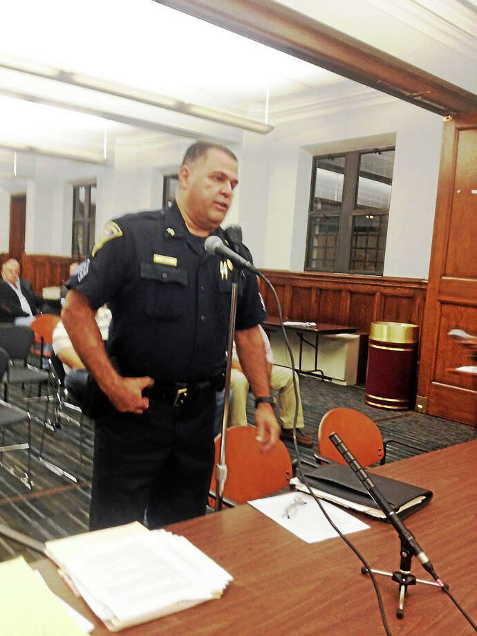 In this file photo, Sgt. Wilfredo Cruz testifies against a special zoning exception for Manhattan Bar & Grill. Photo: Mary O'Leary — New Haven Register File Photo