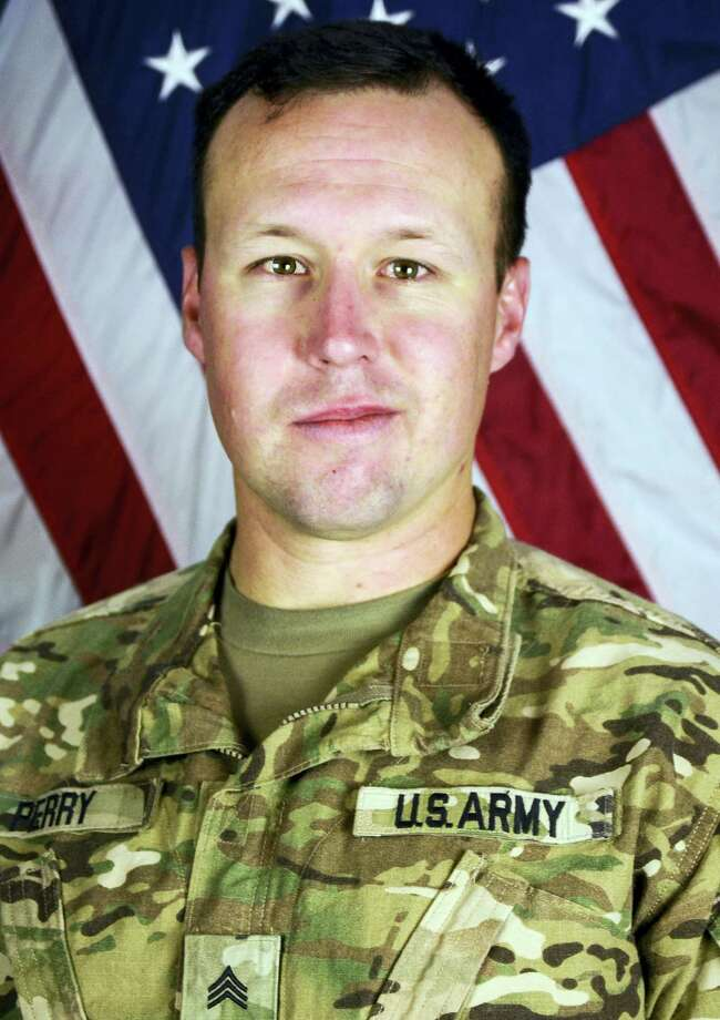 This undated file photo provided by the Fort Hood, Texas Press Center shows U.S. Army Sgt. John W. Perry of Stockton, Calif. Stewart Perry, the father of a soldier recently killed in Afghanistan says he felt disrespected and hurt by passengers who booed him and his family when they were on a flight that was running late to meet his son's remains and passengers were asked to remain seated so they could deplane first. Perry's son, 30-year-old Sgt. John Perry, of Stockton, California, died of injuries inflicted by an improvised explosive device attack Nov. 12, 2016, inside Bagram Airfield. Photo: Department Of Defense Via AP, File / Fort Hood, Texas Press Center