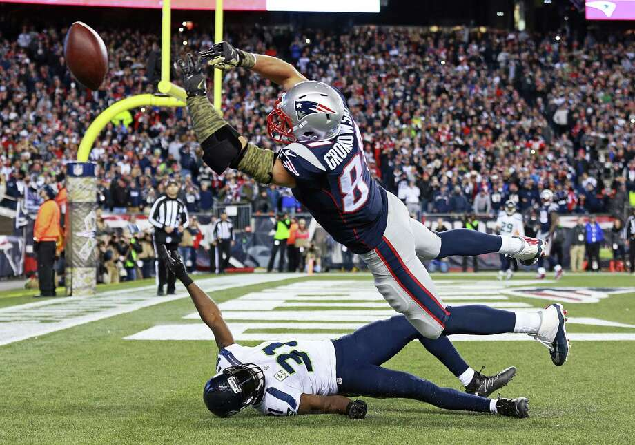 Patriots tight end Rob Gronkowski (87) tries to catch a pass in the end zone over Seahawks safety Kam Chancellor on Sunday. Photo: Matt West — The Boston Herald Via AP   / Matt West