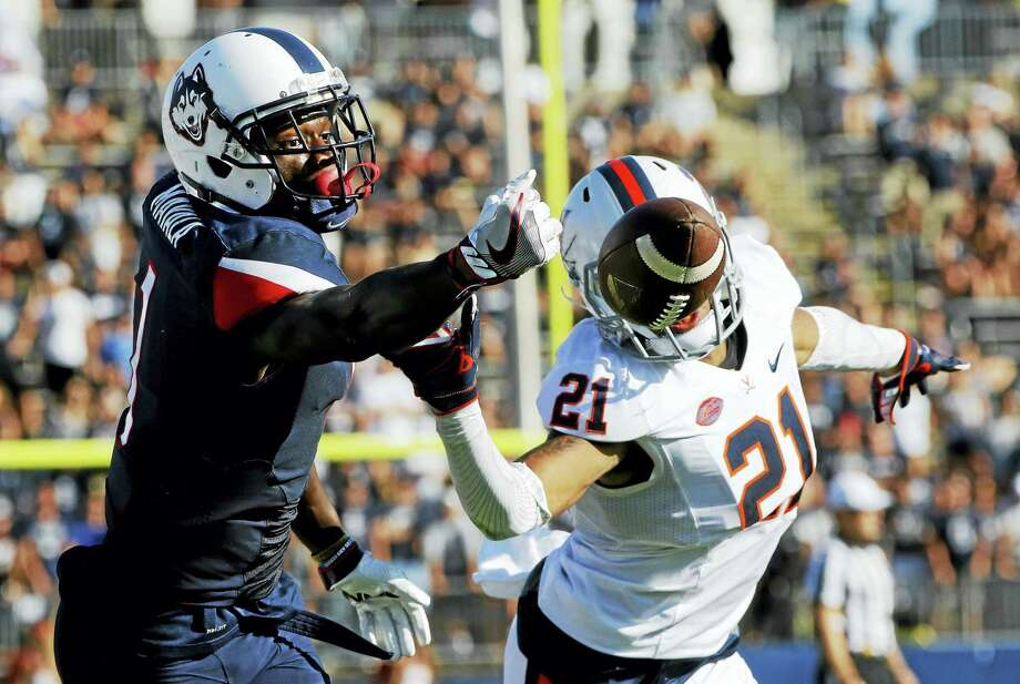 UConn's Hergy Mayala, left, reaches for a pass against Virginia earlier this season. Photo: The Associated Press File Photo   / AP