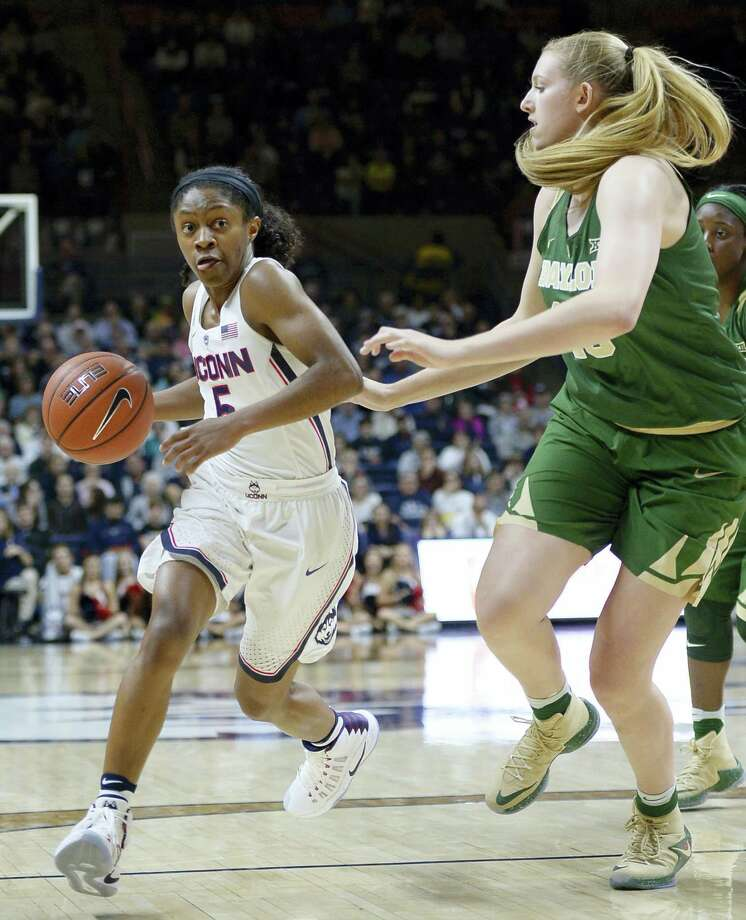 UConn's Crystal Dangerfield dribbles around Baylor's Lauren Cox in the first half Thursday. Photo: Jessica Hill — The Associated Press   / AP2016