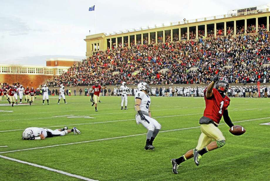 Harvard wide receiver Andrew Fischer (1) runs into the end zone for a fourth-quarter touchdown against Yale in 2014 at Harvard Stadium in Cambridge, Mass. Photo: The Associated Press File Photo   / AP