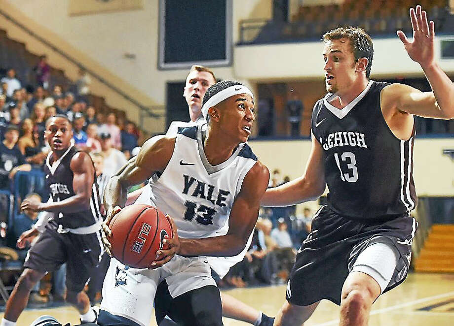 Yale's Trey Phills drives to the hoop Thursday as Lehigh's Matt Holba defends in a 89-81 win in overtime in the Bulldogs' season opener at the John J. Lee Amphitheater at Yale University in New Haven. Photo: Catherine Avalone —New Haven Register