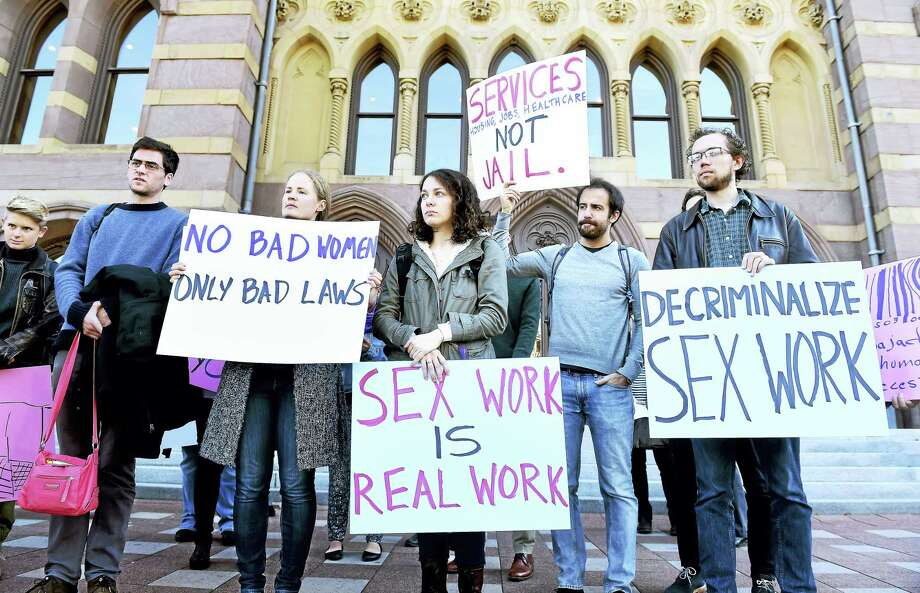 People protest in front of City Hall in New Haven Friday against the arrests of sex workers and the publishing of their names and mugshots in media outlets. Photo: Arnold Gold — New Haven Register