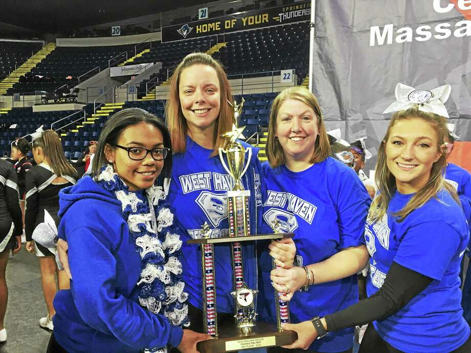 West Haven Seahawks Pee Wee Girls Cheerleading Assistant Coach Asiah Trimble, Head Coach Bridgette Hoskie, Assistant Coach Kristen Teshoney and Assistant Coach Amanda Cardinelli show off the team's hardware after taking second in the New England regional championships last Saturday in Springfield, Mass. Photo: Contributed Photo