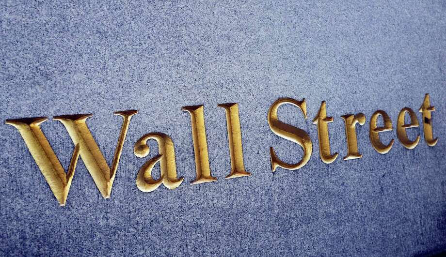 FILE - In this Oct. 7, 2016 file photo, a sign for Wall Street is carved into a building located near the New York Stock Exchange.   Japanese shares rose, Friday, Nov. 18, 2016, on the yen's weakness while other Asian benchmarks wobbled after Fed chair Janet Yellen signaled that policymakers intend to raise interest rates soon. Photo: Mark Lennihan — The Associated Press / Copyright 2016 The Associated Press. All rights reserved.