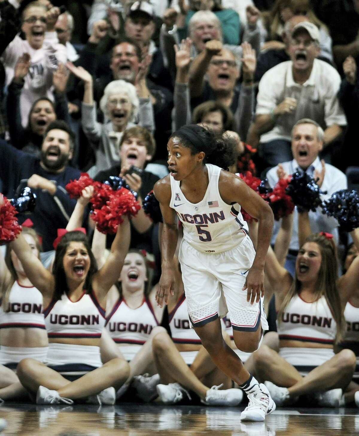 UConn's Crystal Dangerfield watches her shot go in as fans cheer behind her in the second half.