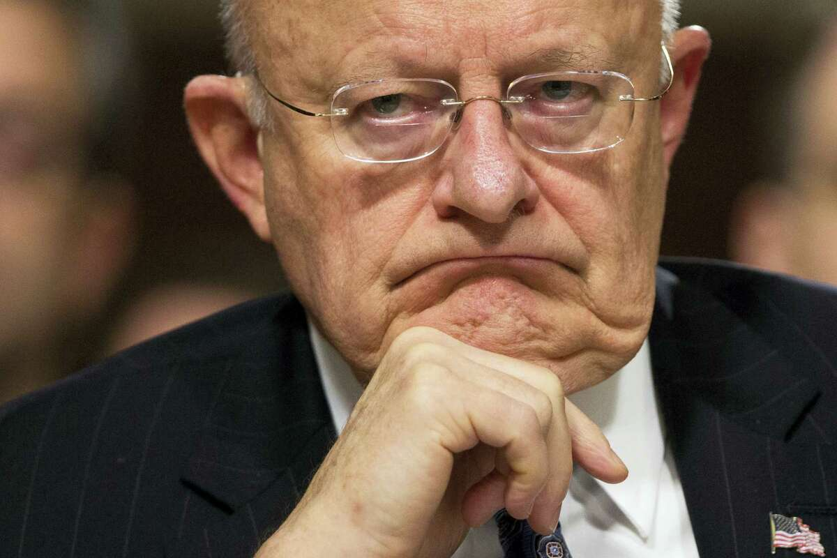 In this Feb. 9, 2016 file photo, Director of National Intelligence James Clapper listens on Capitol Hill in Washington. Clapper has resigned as DNI director.